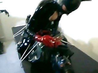 Tied Up Latex Sub At Their..